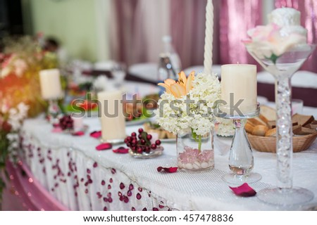 decorations with candles on wedding table in a restaurant - stock photo