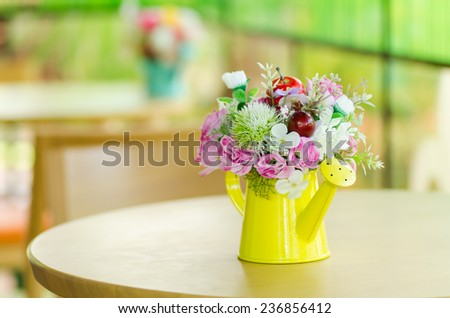 Decorative artificial flower in vase