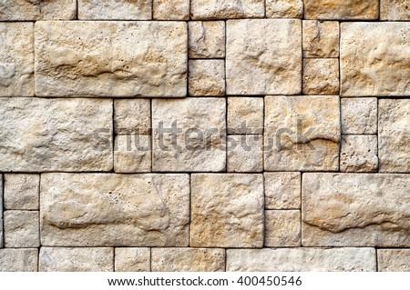 Decorative Beige Stone Random Size Brick Wall Texture For Your Design. - stock photo