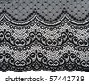 Decorative black lace on insulated white background - stock photo