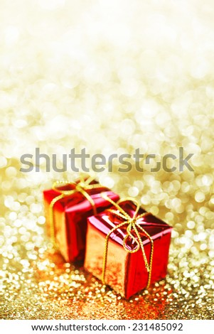 Decorative boxes with holiday gifts on abstract gold background - stock photo