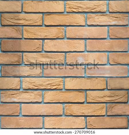 Decorative brick wall - seamless background - retaining wall - stock photo