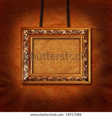 decorative bronze picture frame hung on vintage wall - stock photo