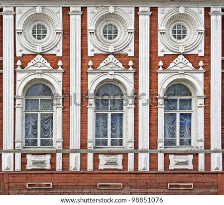 Decorative carved facade of the ancient wooden building - stock photo