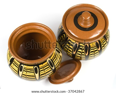 Decorative ceramic jars with lids.  Isolated against a white background.