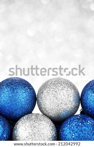 Decorative Christmas balls on abstract glitter silver background