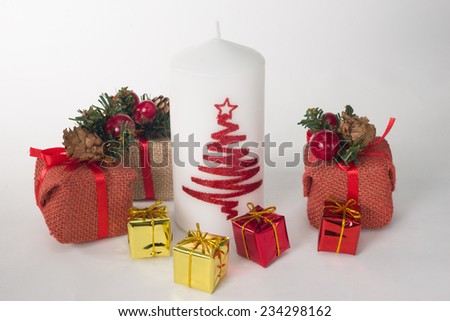 Decorative christmas composition with candle and gifts - stock photo