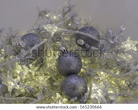 Decorative Christmas ornaments with pretty silver baubles and lights - stock photo