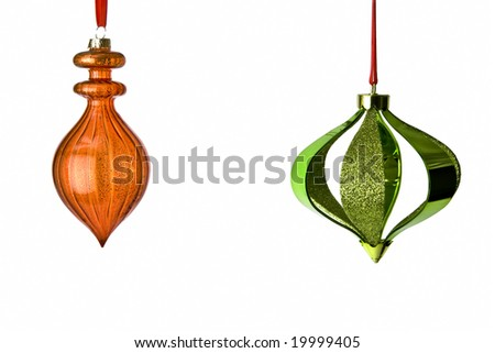 Decorative Christmas Tree Ornaments hanging from red ribbons isolated on white background with clipping path. Lots of room for copy. - stock photo