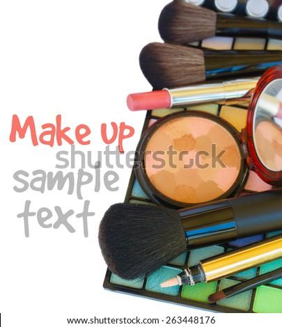 Decorative colorful  make up cosmetics  -  lipstick, brushes  and powder on eye shadowa palette  border isolated on white background - stock photo