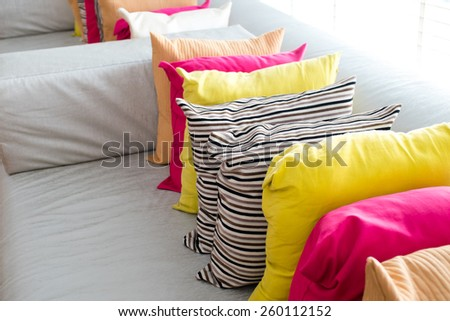 Decorative comfortable pillow natural Fabric, with multi-colored pillows - stock photo