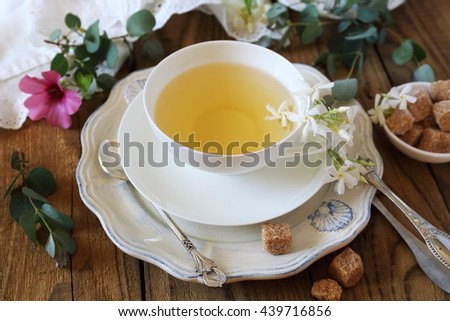 Decorative composition of vintage style: romantic tea drinking with jasmine green tea - stock photo