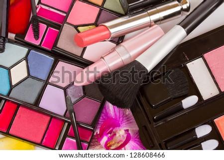 Decorative cosmetics  - eye shadows, lipsticks, mascara - stock photo