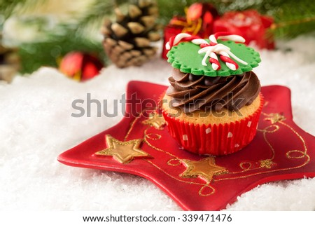 decorative cupcake on plate  with festive Christmas setting - stock photo