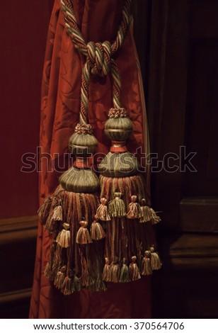 decorative curtain tassel in interior  - stock photo