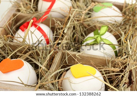 Decorative Easter eggs in wooden basket close up - stock photo