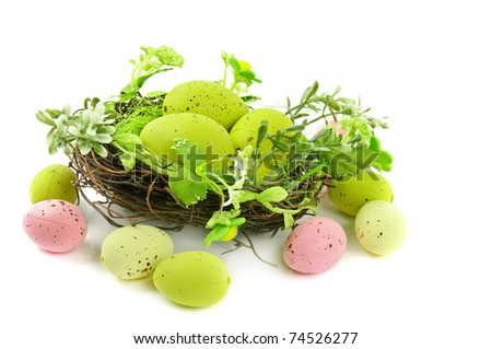 decorative easter nest with egg and spring plants isolated on white background - stock photo