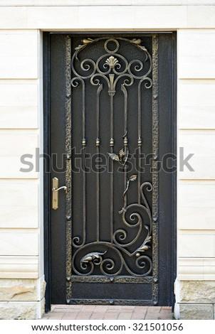 Decorative,   elegance,  wrought  door  in old  stiletto.  - stock photo