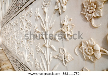 Decorative elements of Taj Mahal created by applying paint, stucco, stone inlays and carvings
