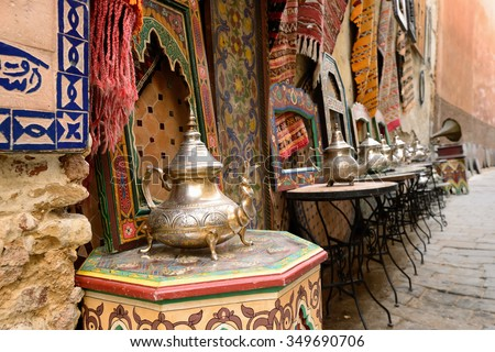 Decorative elements on the souk (market) in the old town, Medina in Morocco. Jug for brewing the tea. - stock photo