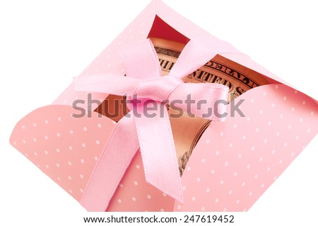 decorative envelopes with ribbon pink and money - stock photo