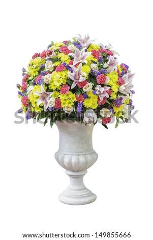 decorative flower arrangement in urn isolated on white background with clipping path - stock photo