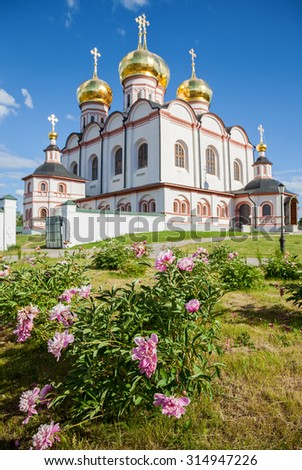 Decorative flowers on the background Cathedral of the Assumption of the Blessed Virgin Mary in the Iversky Monastery, Valday, Russia - stock photo