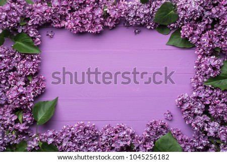 Decorative frame of lilac flowers and space for text. Lilac background for design