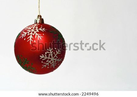 Decorative globe, with snowflakes, red, white background - stock photo
