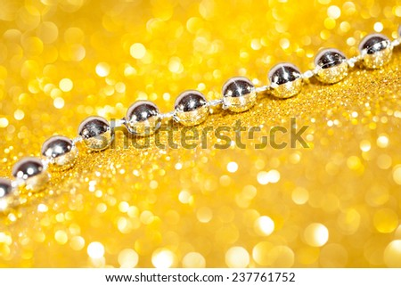 Decorative gold background with sparkling. studio shot - stock photo