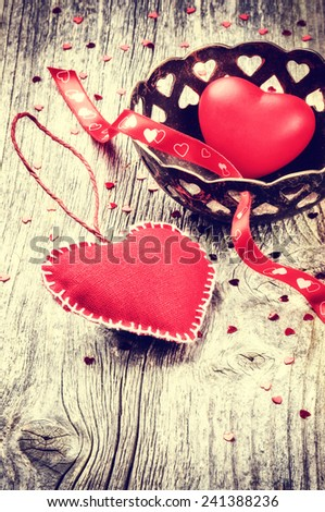 Decorative hearts in retro style on old wood background