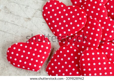 Decorative hearts pile on dirty canvas background