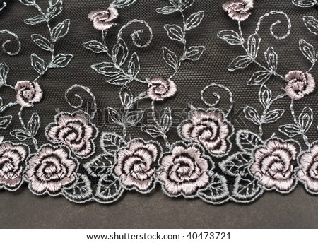 Decorative lace with pattern on gray background - stock photo