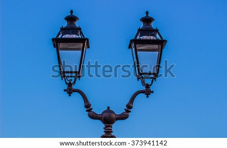 Decorative lamppost with blue background - stock photo