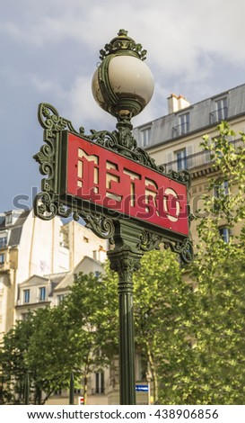 Decorative lantern and a pointer entry in the Paris metro. France - stock photo