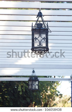 decorative lantern hanging in the arbor
