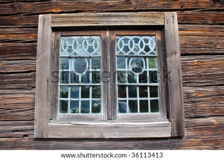 Decorative Lead glass window on old wooden barn