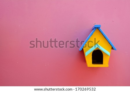 Decorative nesting wood box on violet wall background - stock photo