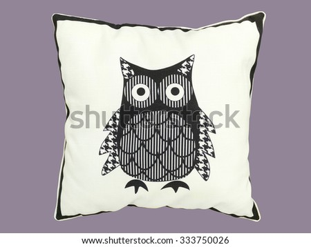 Decorative pillow with pattern of owl against gray background - stock photo