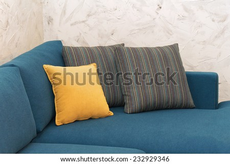 Decorative pillows on corner of modern sofa