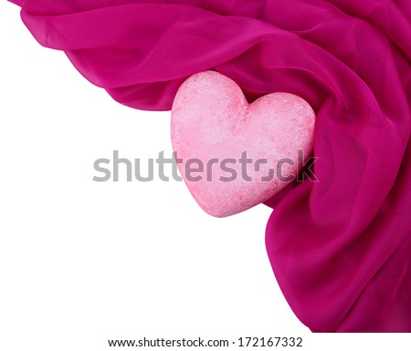 Decorative pink heart, on color fabric, isolated on white