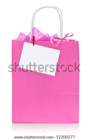 Decorative pink shopping bag with blank tag or label, isolated on white background - stock photo