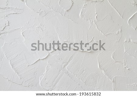 Decorative plaster effect on wall - stock photo