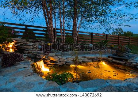 Decorative pond at night - stock photo