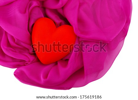 Decorative red heart, on color fabric, isolated on white