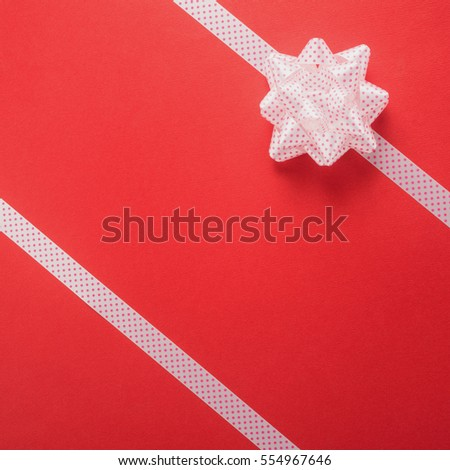 Decorative ribbon and bow on a red background