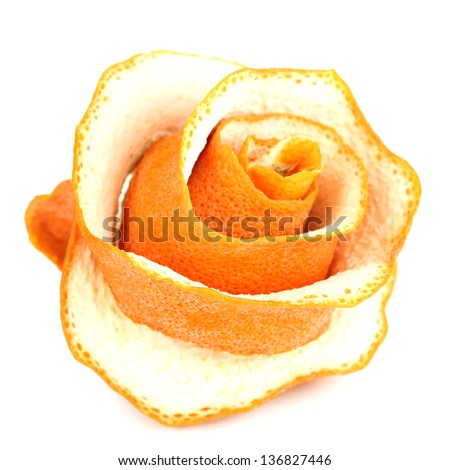 Decorative rose from dry orange peel isolated on white