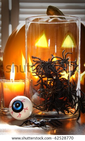 Decorative spiders in glass container for Halloween - stock photo