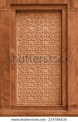 Decorative stone panel on the wall on facade of the building. India, Agra - stock photo