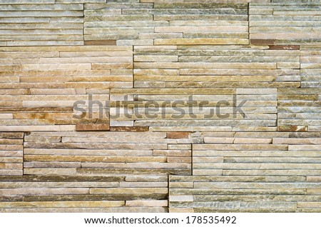 Decorative stone tiles on a wall texture. - stock photo